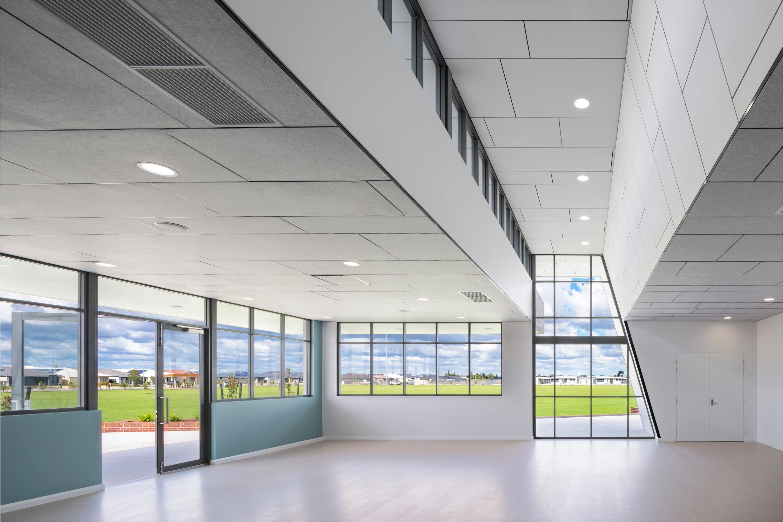 Indoor meeting or community room with skylight windows and view to playing fields at Rossiter Pavilion