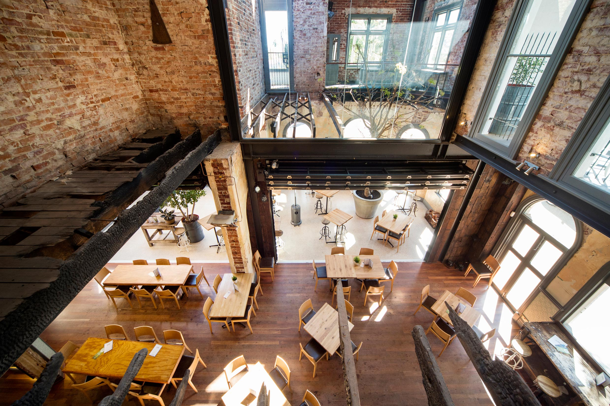 The Guildford Hotel heritage dining room with restored brick walls, steel beams and original burnt timber beams
