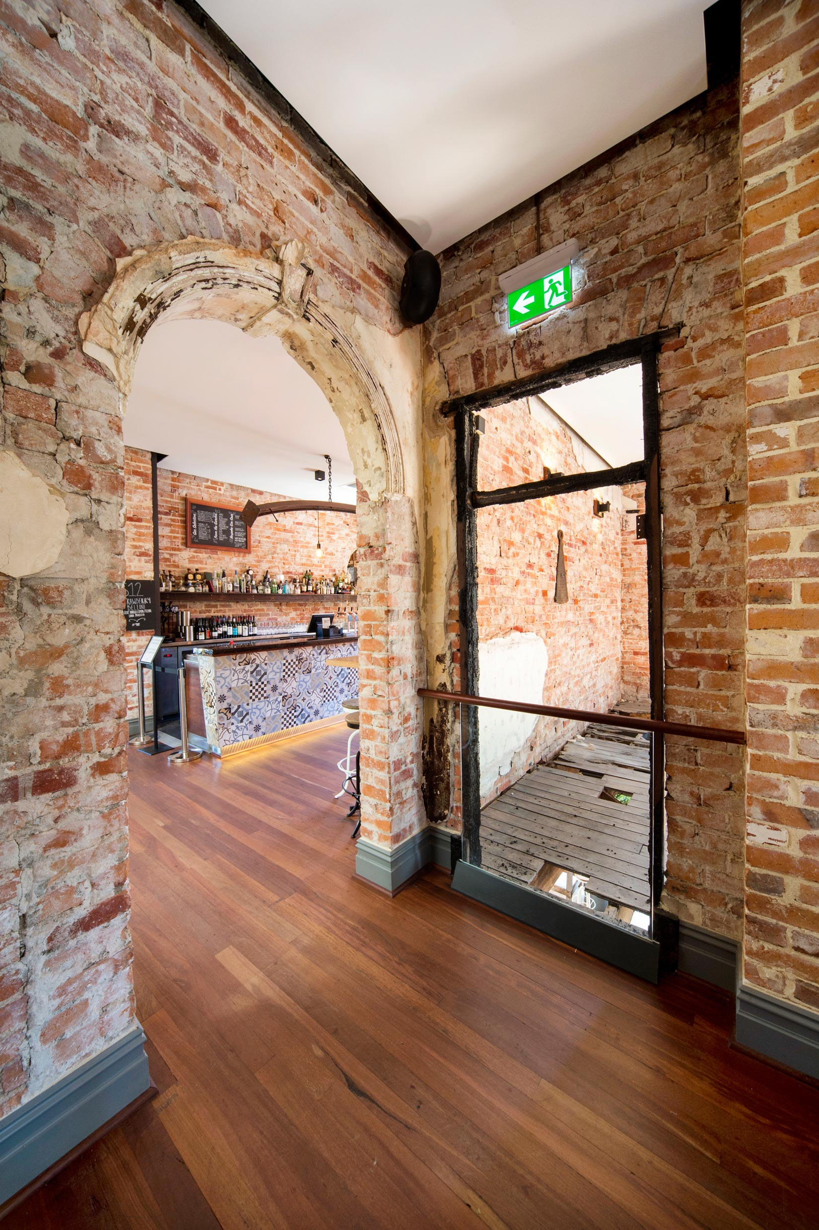 The Guildford Hotel restored brick wall with arch doorway