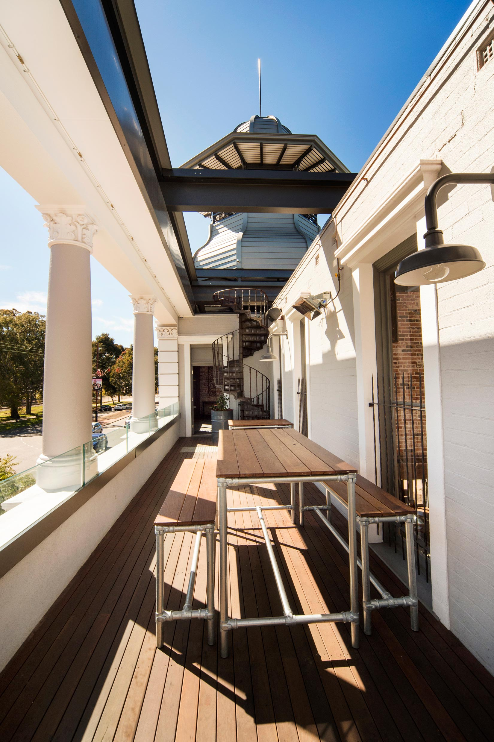 The Guildford Hotel balcony with white brickwork walls, white corinthian columns and belvedere in the background