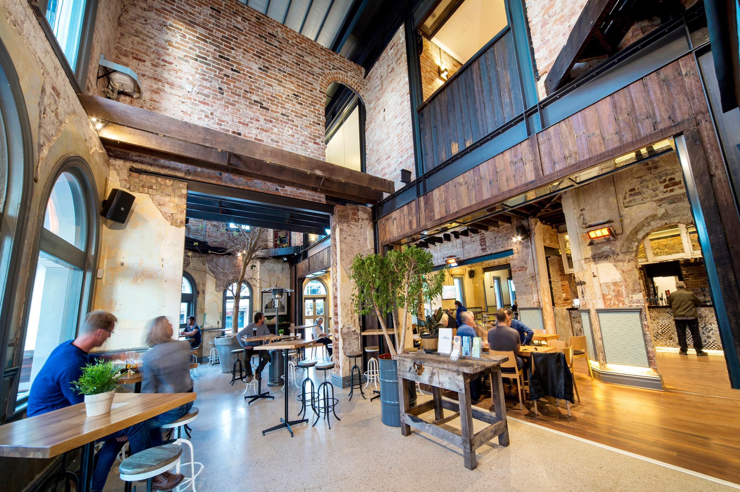 heritage dining room at the Guildford Hotel with brick walls, archways, and restored timber beams