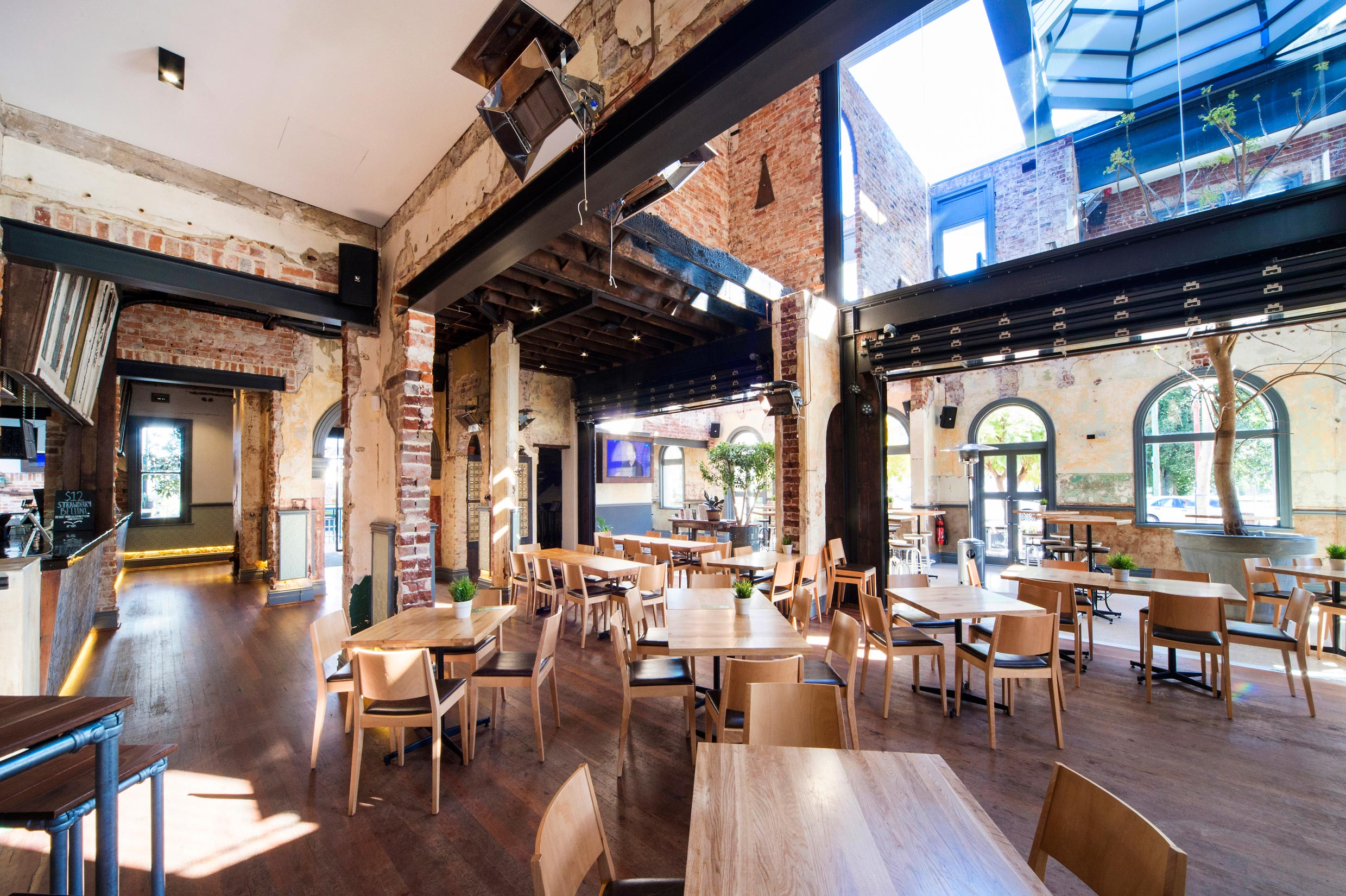 The Guildford Hotel heritage dining room with restored brick walls, steel beams and timber floors