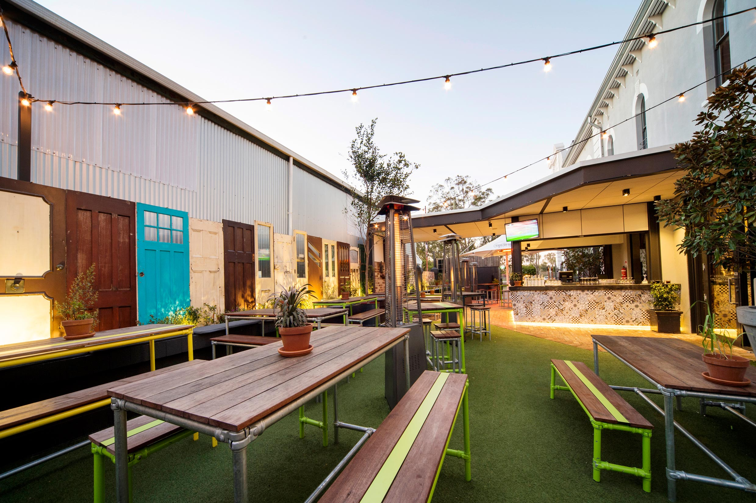 beer garden with grass and fairy lights at the Guildford Hotel