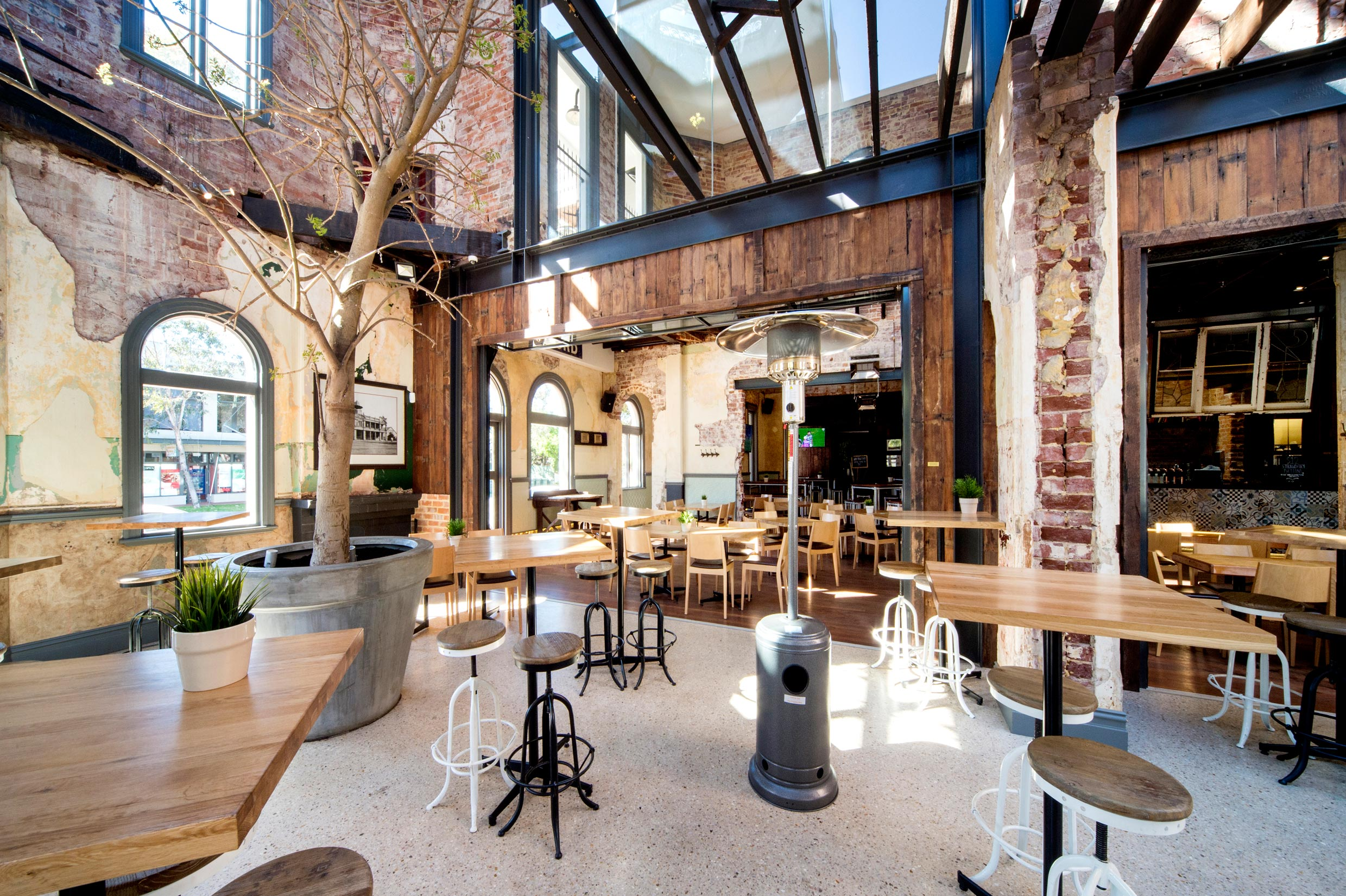 The Guildford Hotel heritage dining room with restored brick & timber walls, steel beams and concrete floors