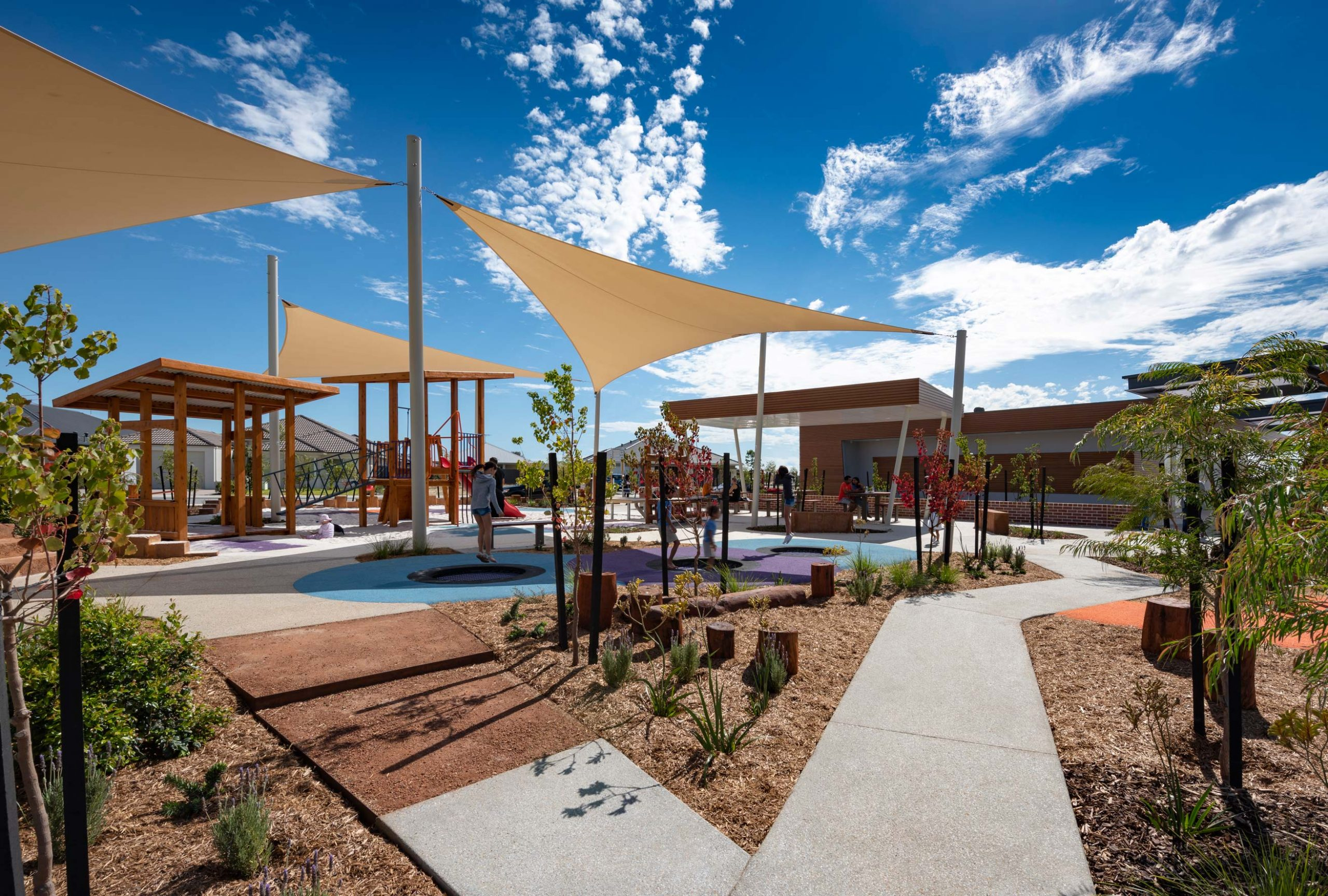 Nature playground with shade sails and plants at Rossiter Sports & Community Pavilion