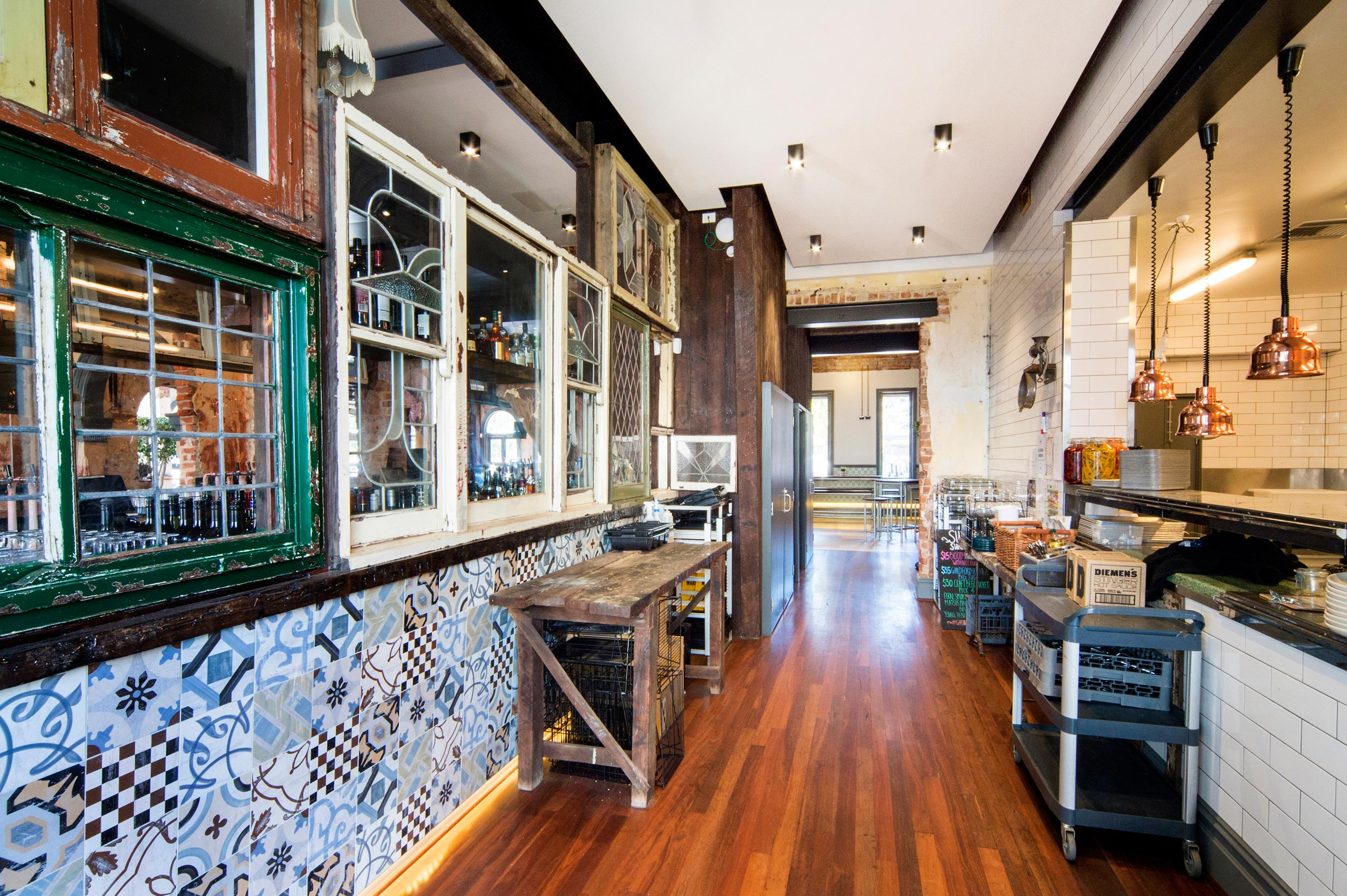 The Guildford Hotel heritage kitchen with timber floors, tiled walls and heritage windows