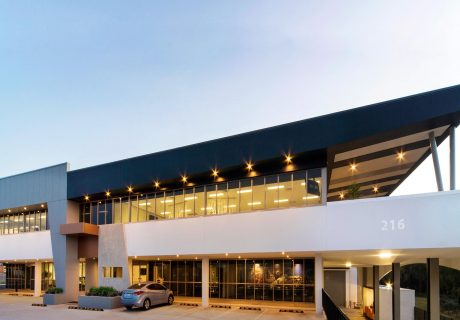 White, grey, and black office building in Balcatta with large angled cantilevered roof