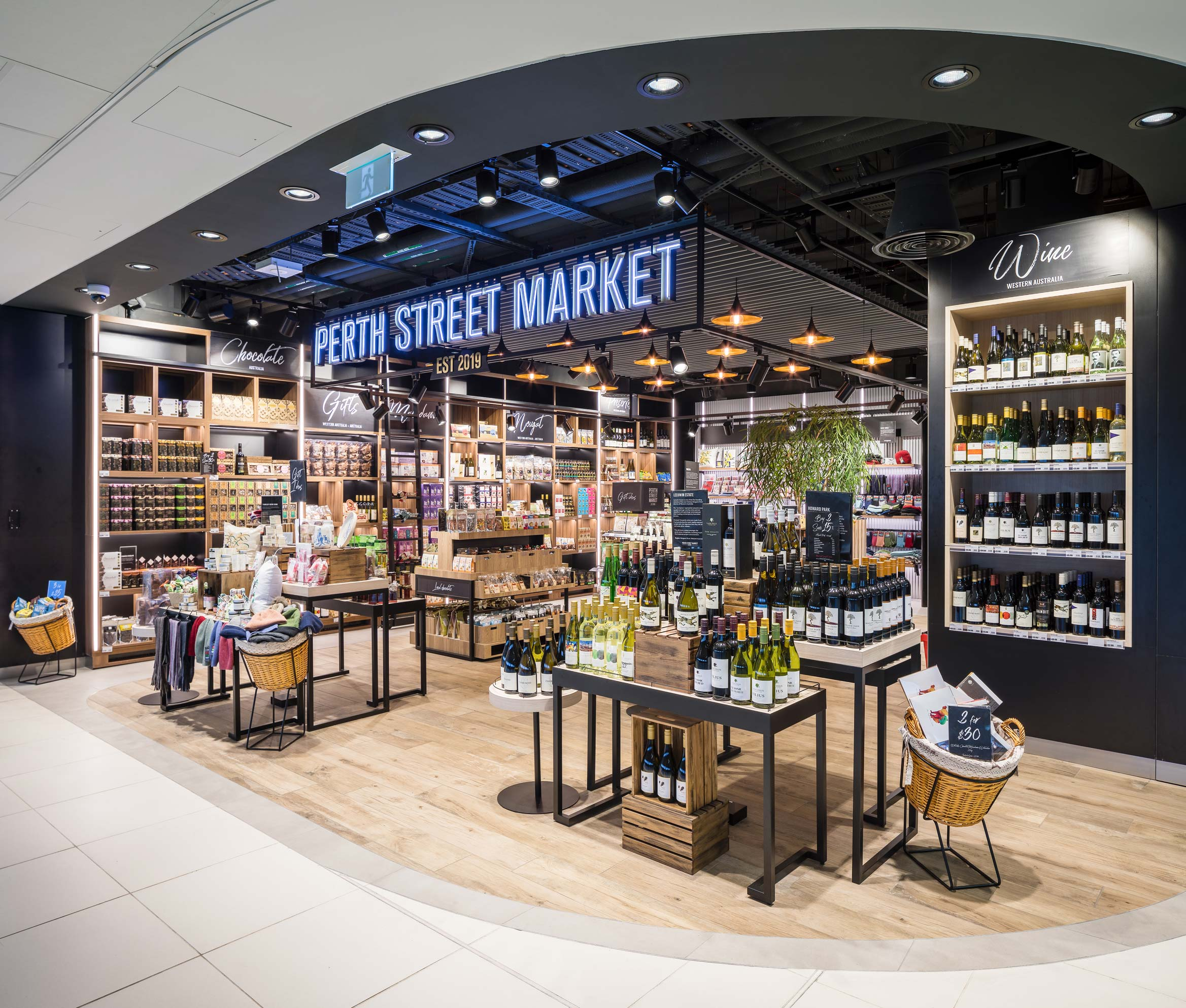 Australiana themed retail shop called Perth Street Market at Perth International airport Duty Free, with timber flooring and shelves of wine
