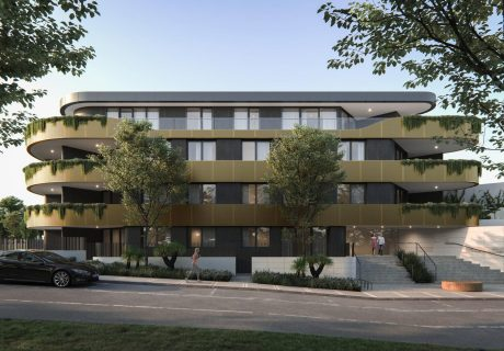 4 Storey Mosman Park Fairlight apartment building with golden curved balconies and dark grey walls