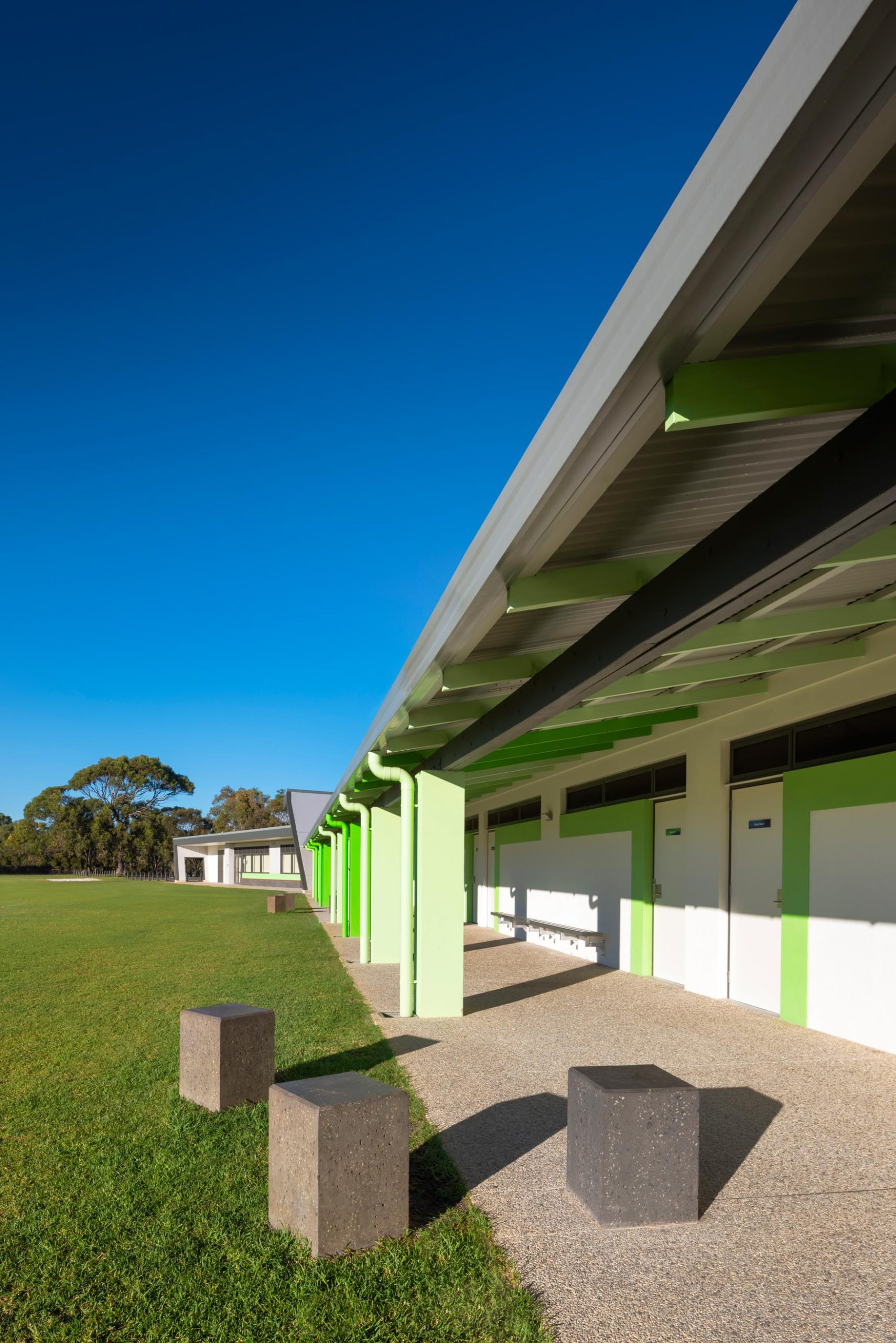 Carine Hall Recreation Centre outdoor covered walkway with green columns and beams