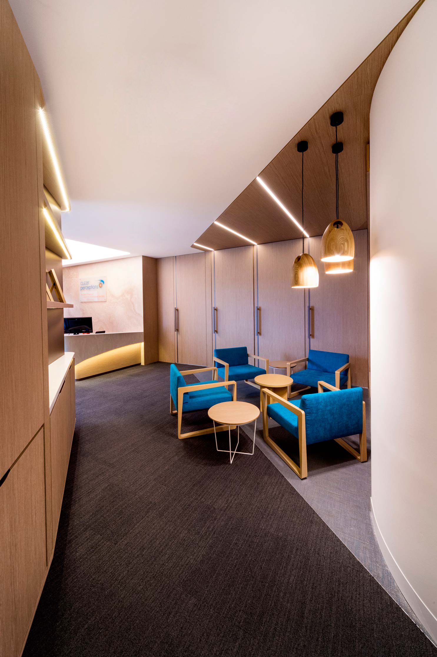office waiting lounge with timber cabinet walls and timber doors