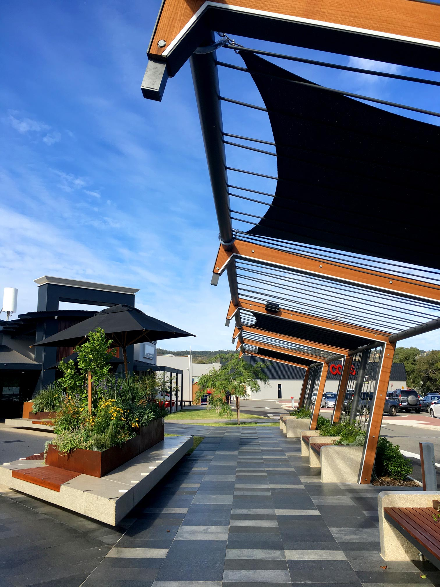 shaded angled timber & steel trellis next to footpath to the entrance of Forrestfield Forum Shopping Centre