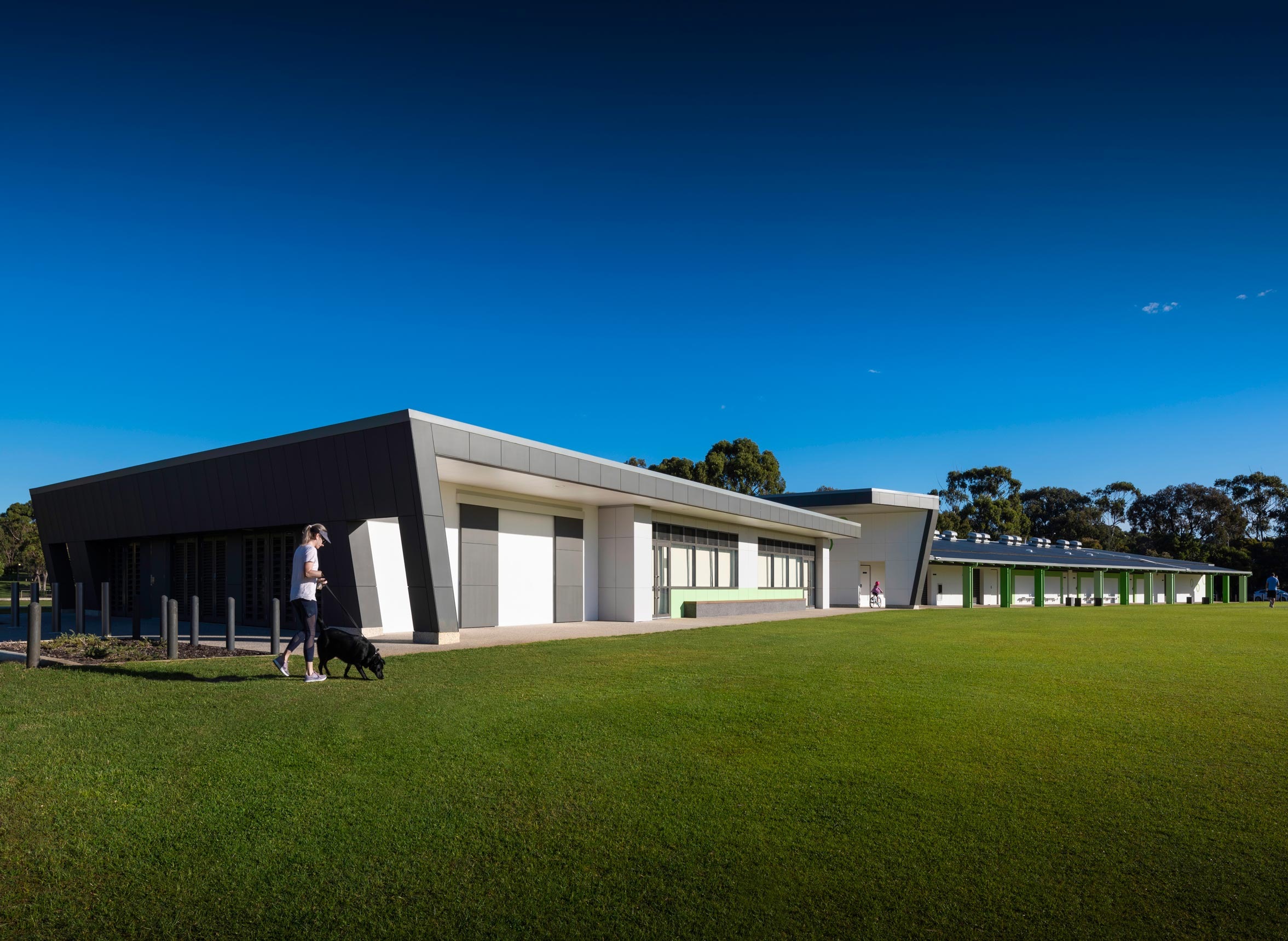 Carine Hall Recreation Centre with dark grey angled walls and sporting fields in front