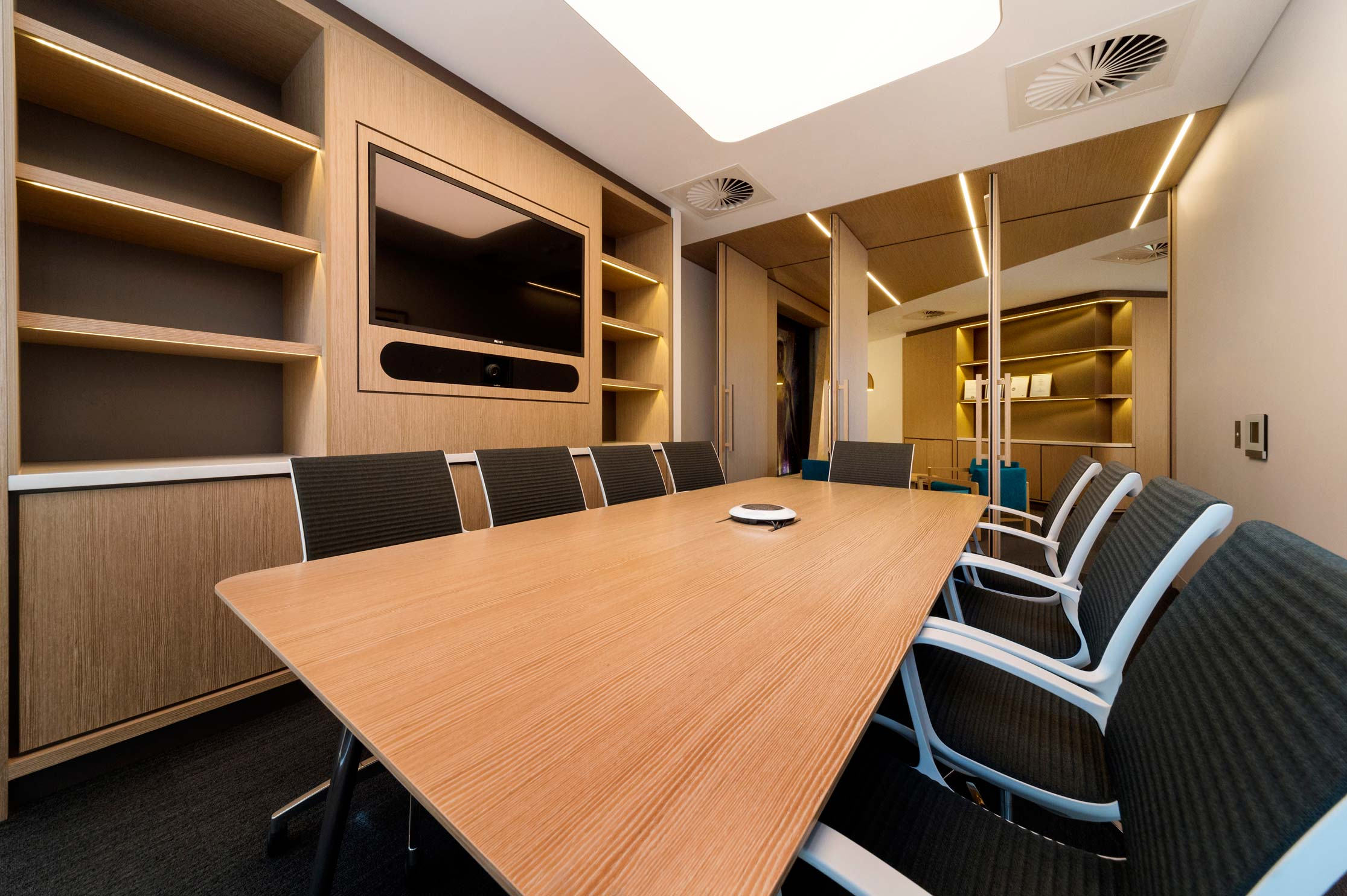 timber cladded office boardroom with pivoting doors