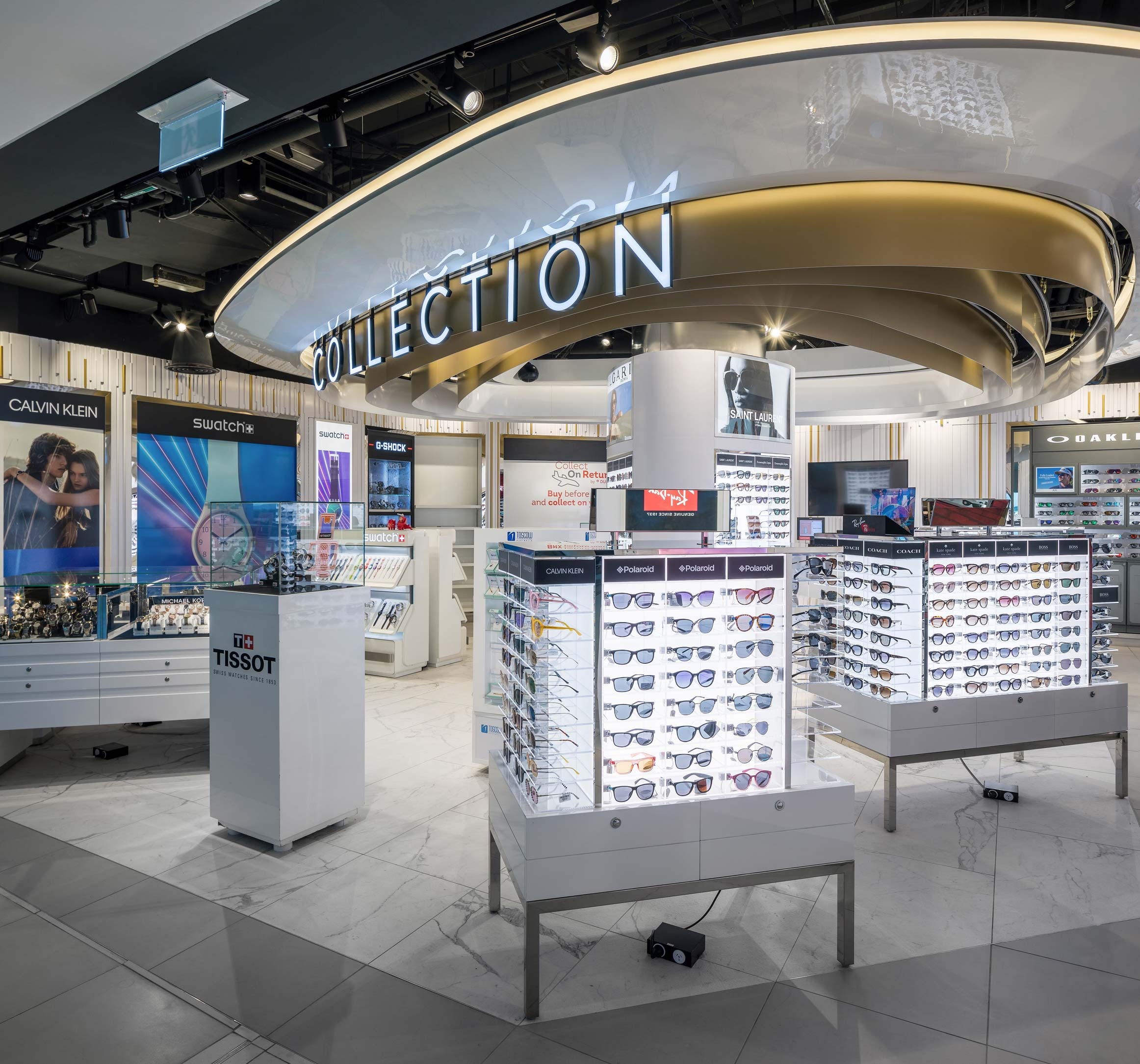 White Duty Free sunglass and watch kiosks with large neon Collection sign at Perth International Airport