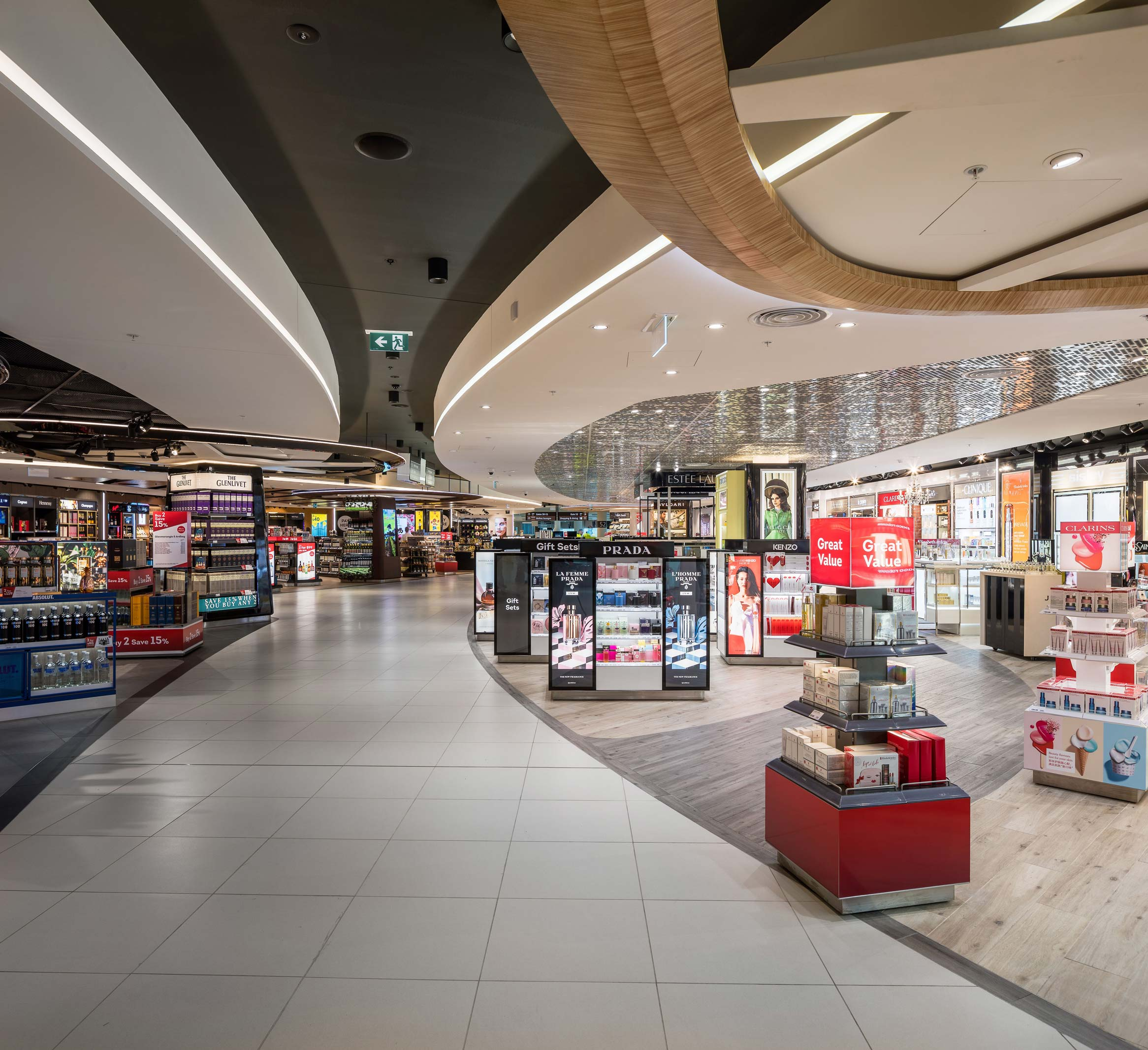 Beauty retail stands at the Perth International Airport Duty Free shopping area with sparkled silver & timber ceiling