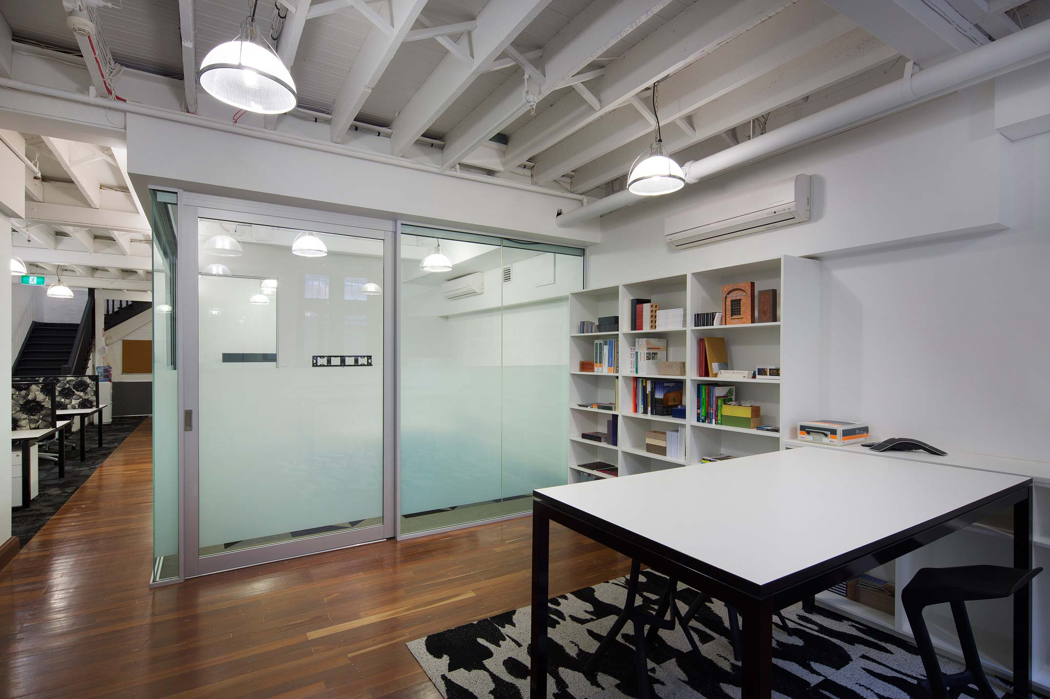 Austral Brickworks design studio office with timber flooring and white timber ceiling