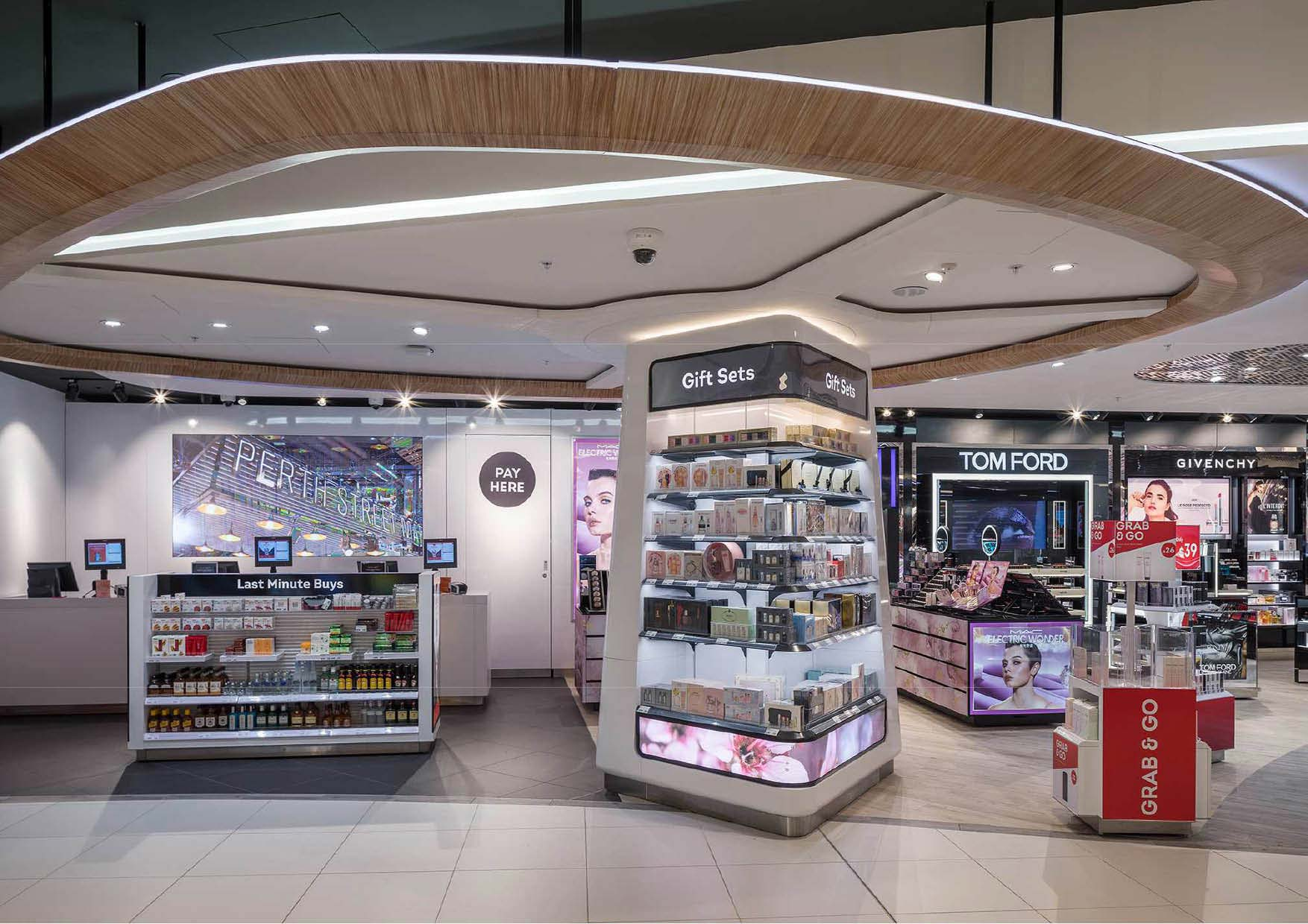 Beauty retail stands at the Perth International Airport Duty Free shopping area with circular timber ceiling feature