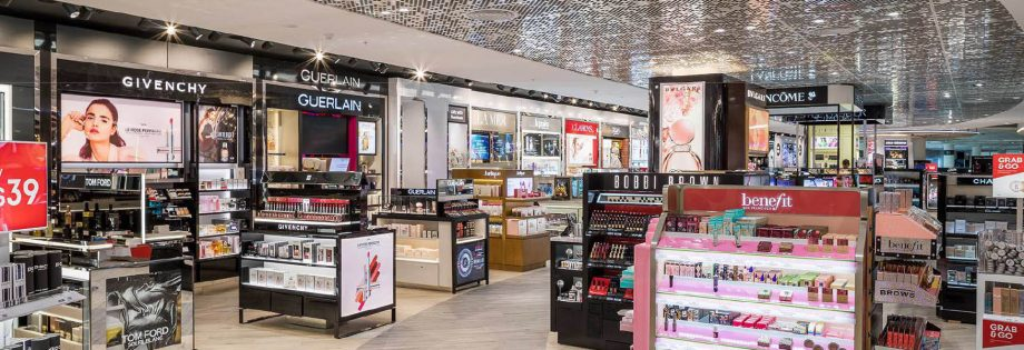 Beauty retail stands at the Perth International Airport Duty Free shopping area with sparkled silver ceiling