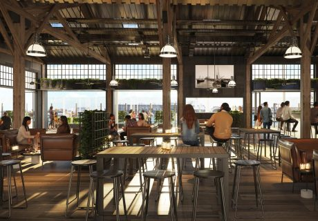 fremantle heritage warehouse bar and dining area with ocean views, large timber beams, and warehouse lights