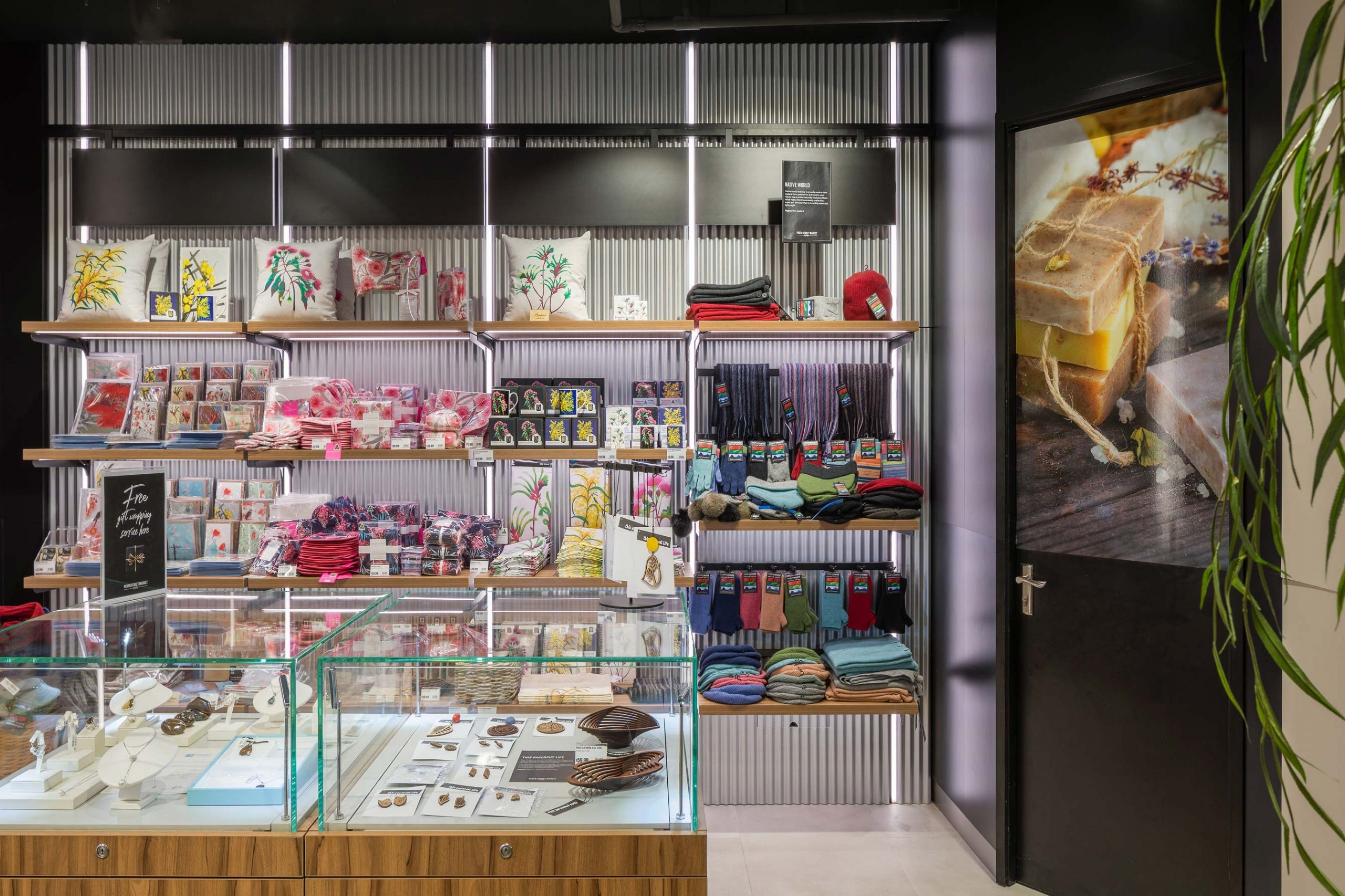 Australian themed Duty Free Shop at Perth International Airport with corrugated tin walls and floral printed gifts