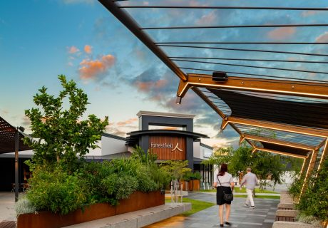 Outdoor walkway with angled timber and steel trellis with vegetation growing up at Forrestfield Forum Shopping Centre