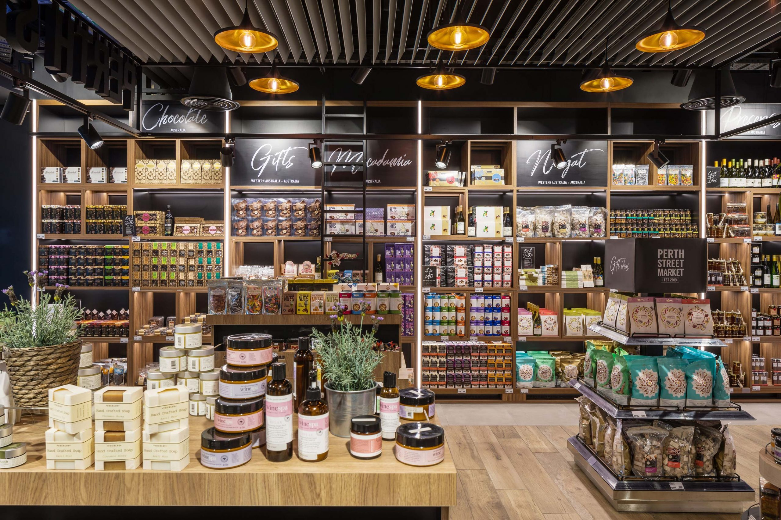 Australian themed Duty Free shop with timber flooring and shelves at Perth International Airport