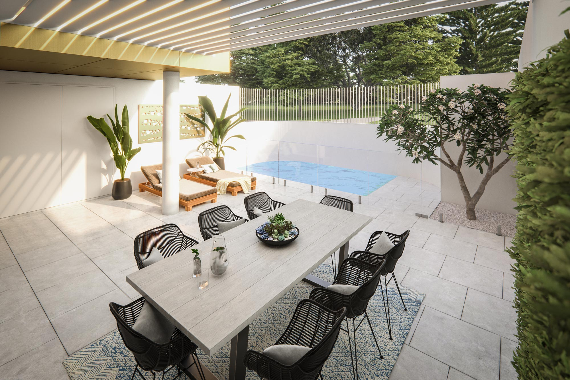 Covered alfresco area with pool, dining table, paving and side garden at Elizabeth Residences Cottesloe Apartments